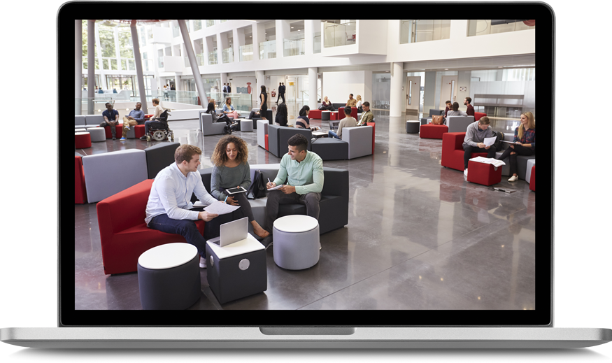 laptop screen featuring professionals lounging in a hotel atrium lounge