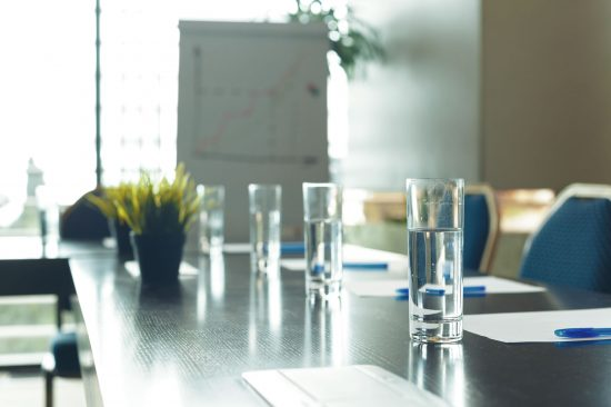 boardroom table with glasses of water