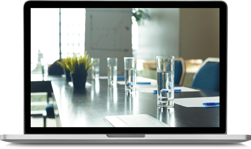 laptop screen featuring a boardroom table with water glasses